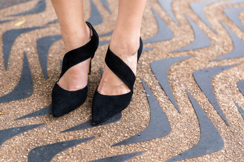 Close up of my pointed heels, standing on a boomerang-printed path