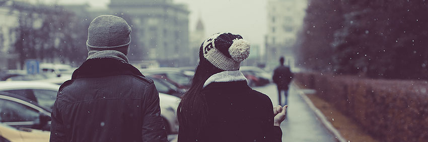 A couple walking together on a snowy day