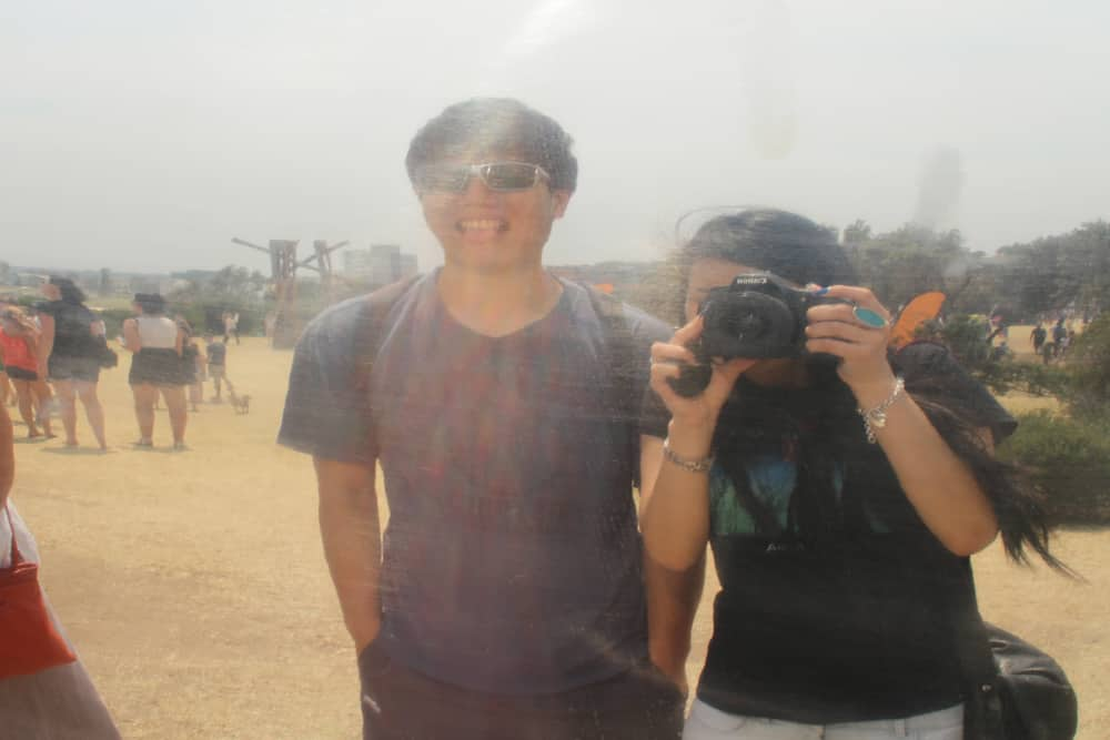 James and I looking into the reflective surface of 'life reflection xx #1' by Byung-Chul Ahn