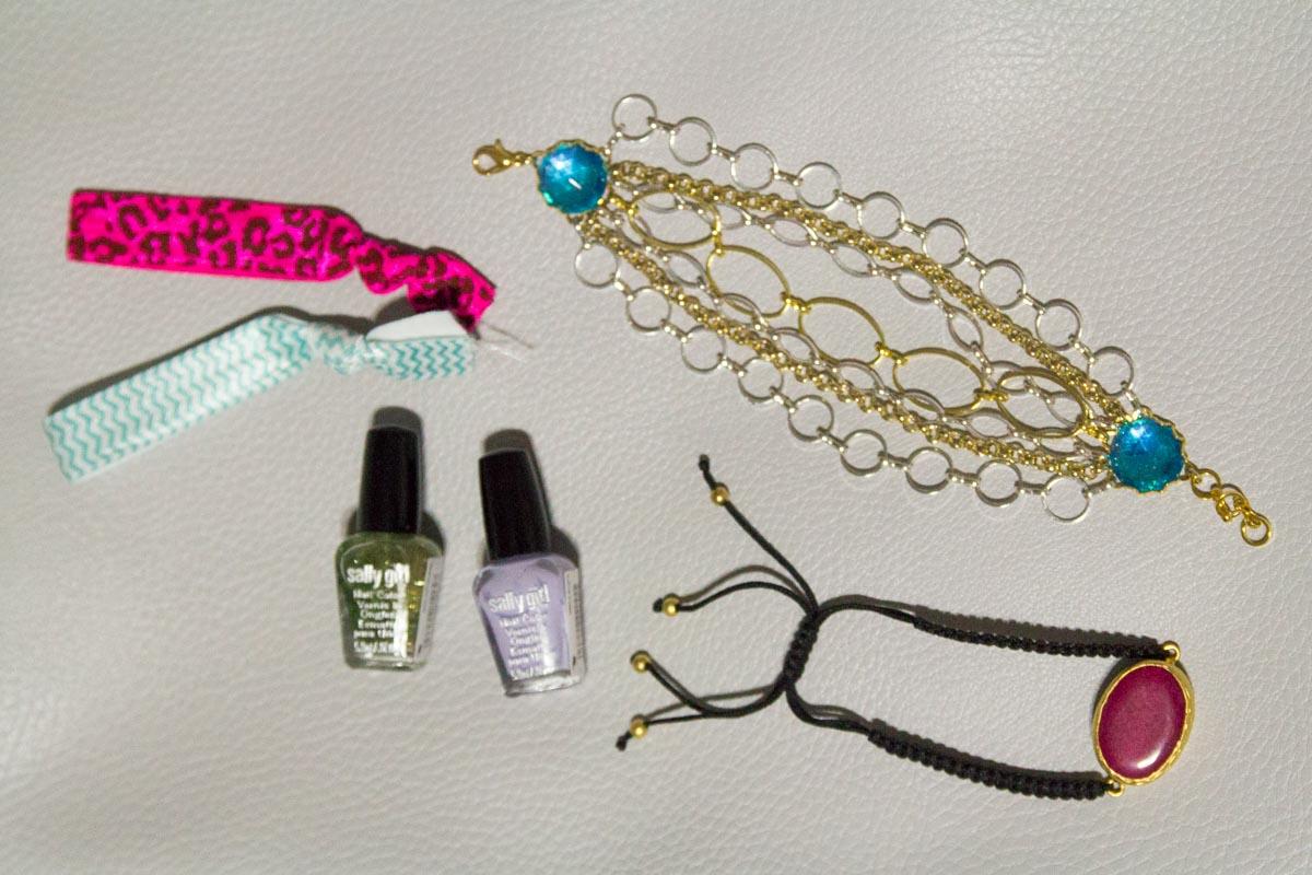 Flat lay of polish, hair ties and bracelets