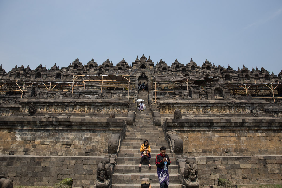 Front view of people going up the temple steps