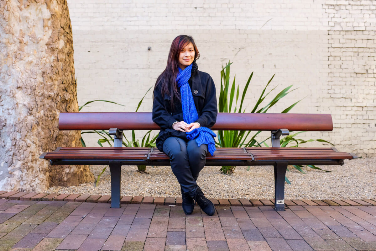 Sitting on a bench in a courtyard