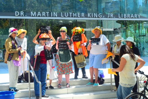 Raging Grannies holding signs of victims of police violence