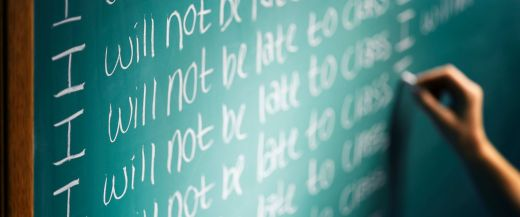 "Image: Green chalkboard with ""I will not be late to class"" repeated over and over again Photo: ABC"