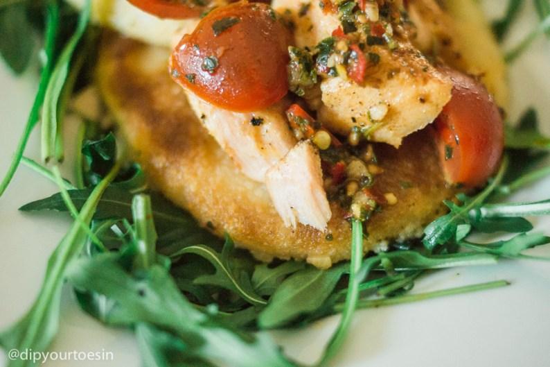 Arepas witth blackened salmon & tomato-basil relish. Closeup