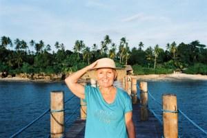 Woman standing on pier at Zanzi Resort, Zanzibar | @dipyourtoesin