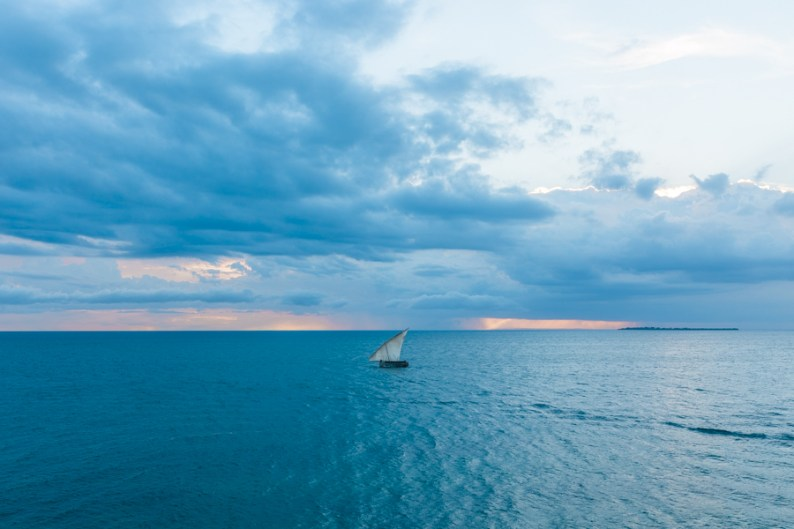 Dhows going out for fishing, sunset, Stone Town, Zanzibar