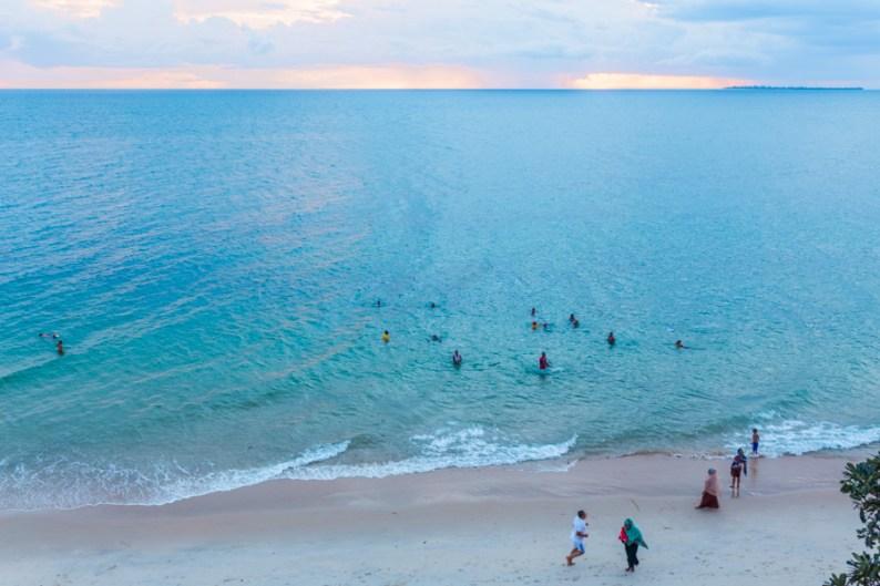 Locals enjoying an evening on beach in Stone Town, Zanzibar