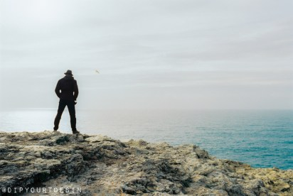 Standing at the end of the world at Cape of St. Vincent, Algarve