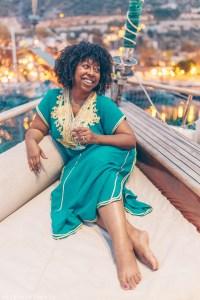 Black woman drinking Turkish wine on a yacht