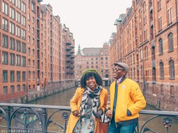 Black couple looking at warehouses in Speicherstadt, Hamburg