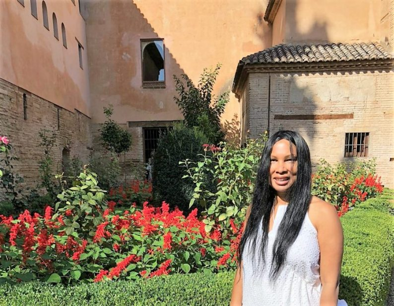 Woni Spotts Spain | First Black Woman to Travel To Every Country in the World?