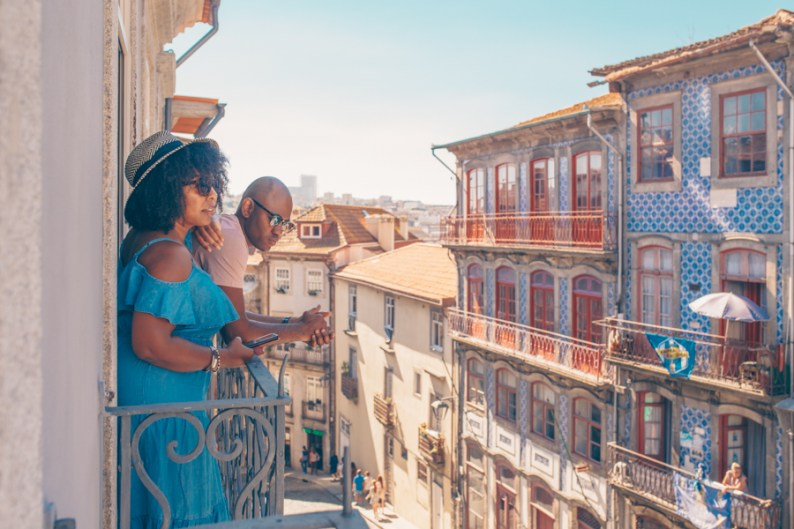 Couple on balcony in Porto | Visit Portugal in One Week with TAP Air Portugal