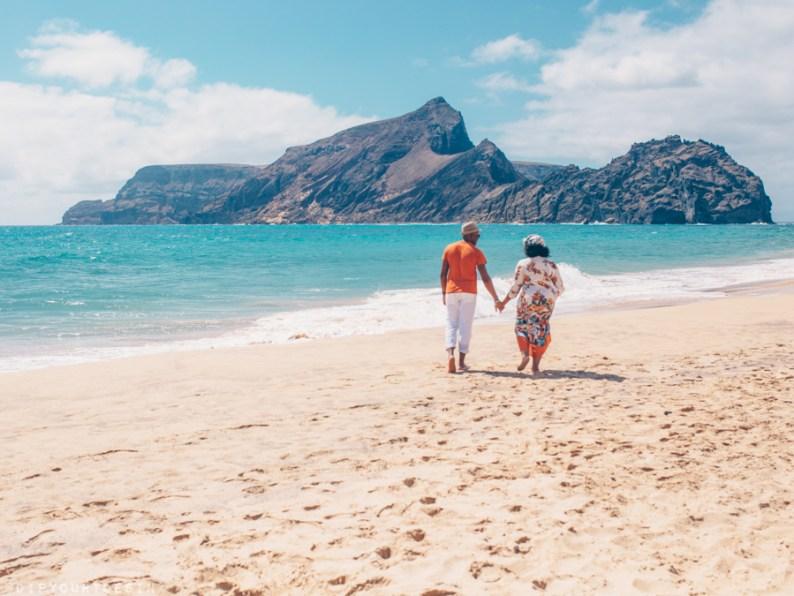 Couple walking along beach in Porto Santo