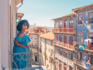 Woman on balcony in Porto | Visit Portugal in One Week with TAP Air Portugal