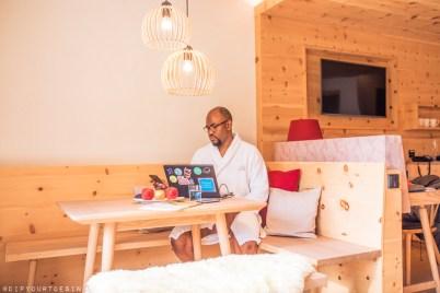 Man working in room at Bio-Hotel Rupertus, Leogang