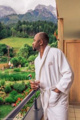 Man on balcony in Bio-Hotel Rupertus