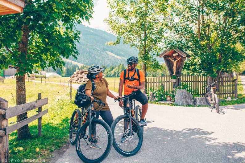 Couple cycling in Leogang, Salzburgerland, Austria