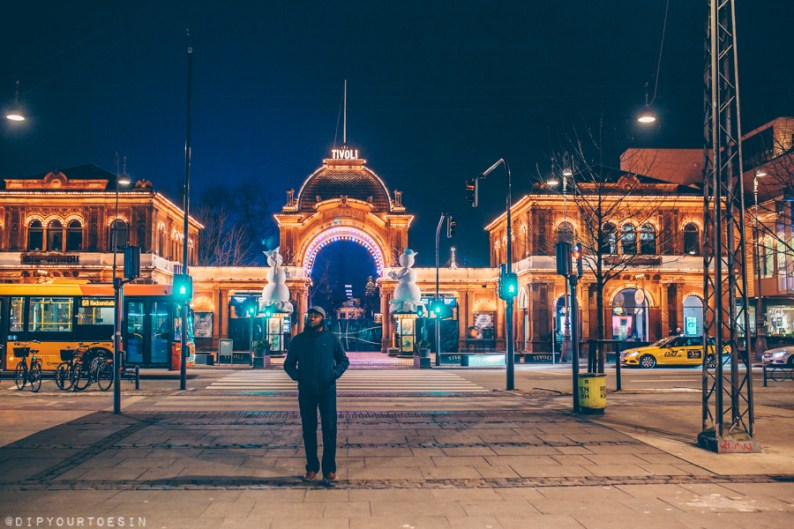 Man walking outside Tivoli Gardens in Copenhagen | Dear Copenhagen