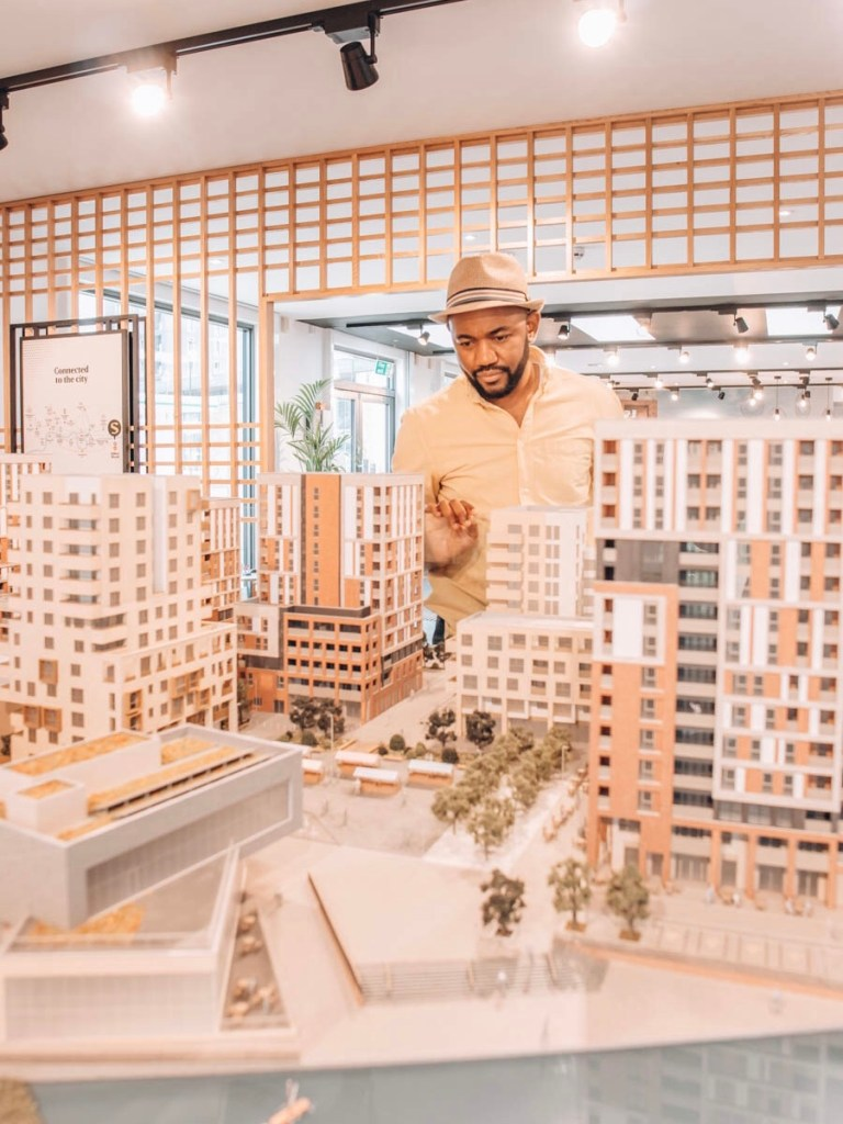 Man looking at model version of Southmere, Thamesmead, Peabody Housing Association
