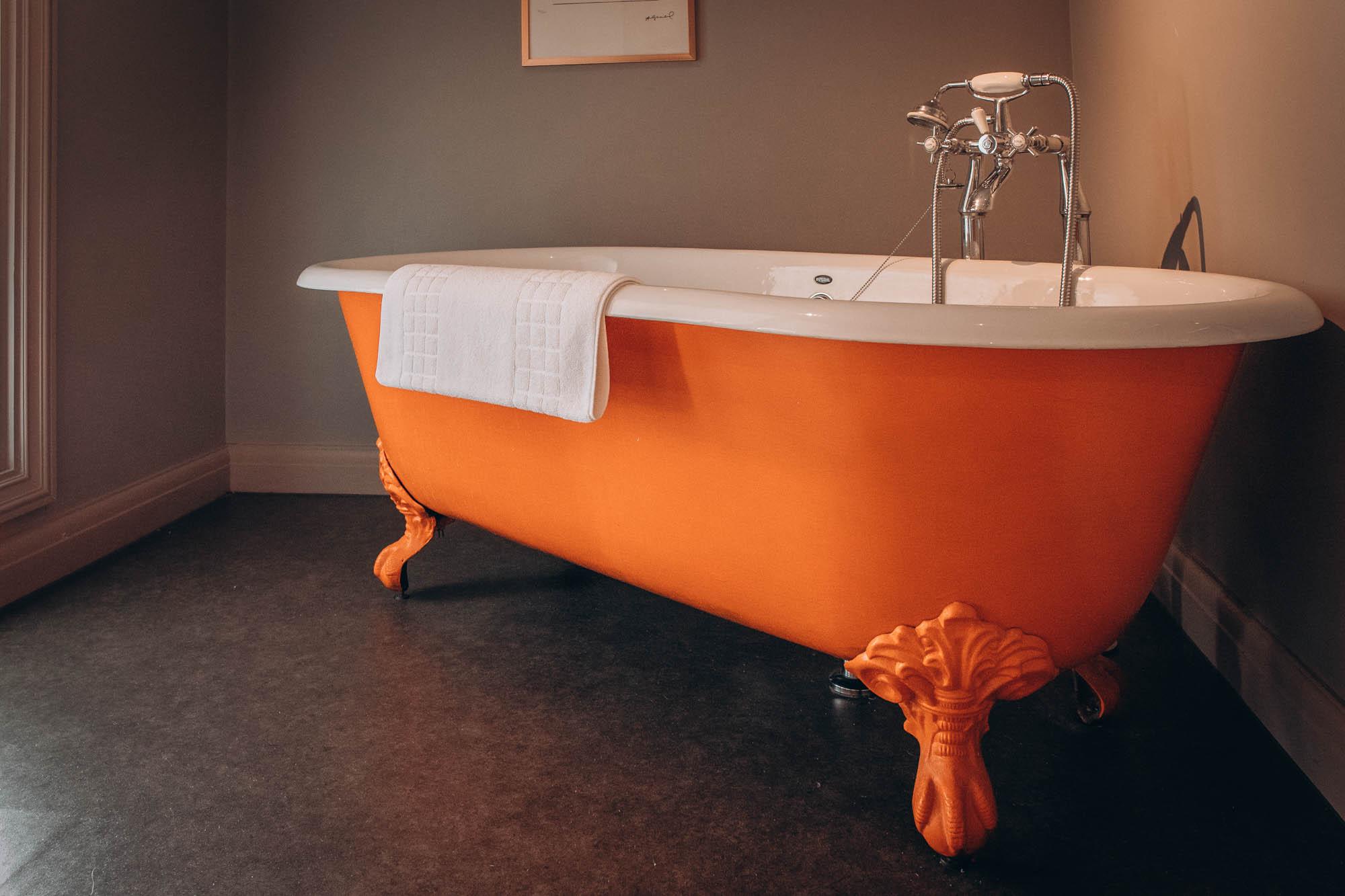 Boutique hotels   Orange bath tub at The Old House, Effingham Road, Copthorne, West Sussex