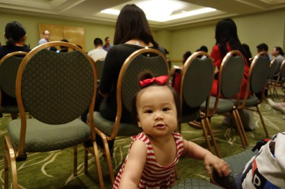 eva in the audience of her dad's session at aaja's national convention in new york.