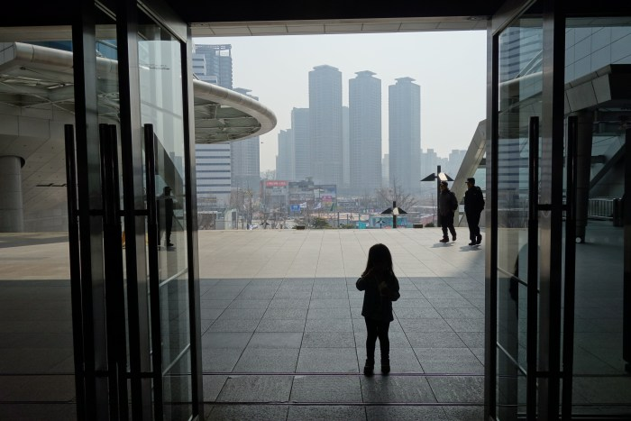 "daughter eva, on a day when pollution in seoul measured ""hazardous for all groups,"" not just children and old people."