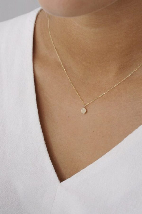 Ethically-made Classic Gold Dot Necklace when worn around the neck creates a neat and elegant look.