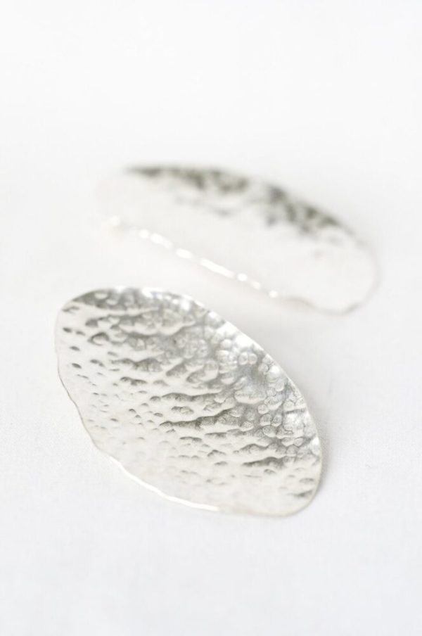 Ethically-handmade rugged Leaf Style Silver Earring made with Sterling Silver in white background.