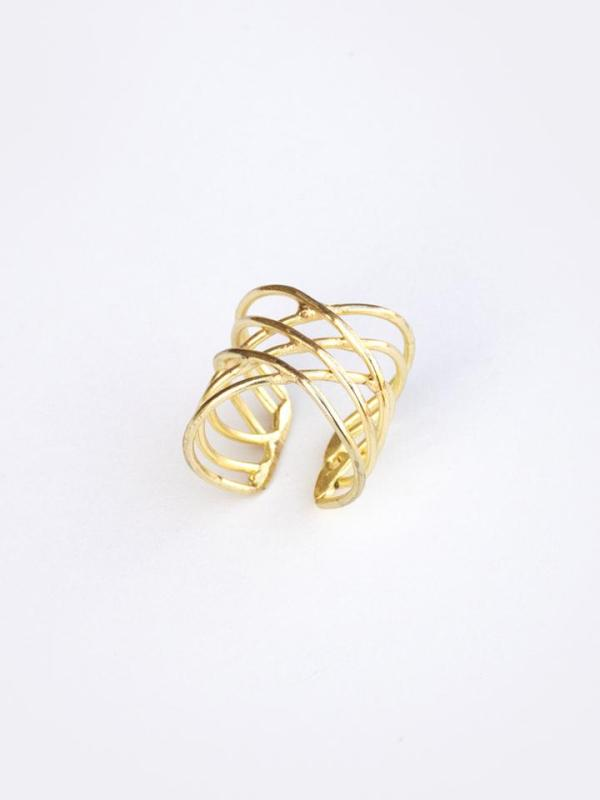Trendy ethically-made oval infinity ring made of brass on a white background.