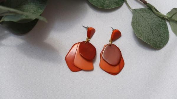 Ethically-sourced Orange Red Stone treasure dangling earrings design with three overlapping pieces mimicking petals.