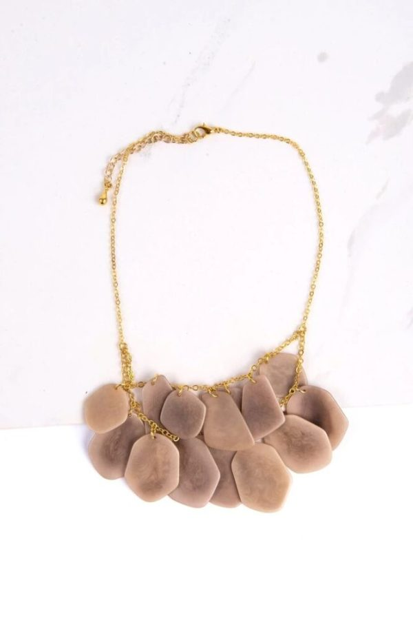Ethically made neutral stone treasure necklace made of dangling overlapping tagua seeds.