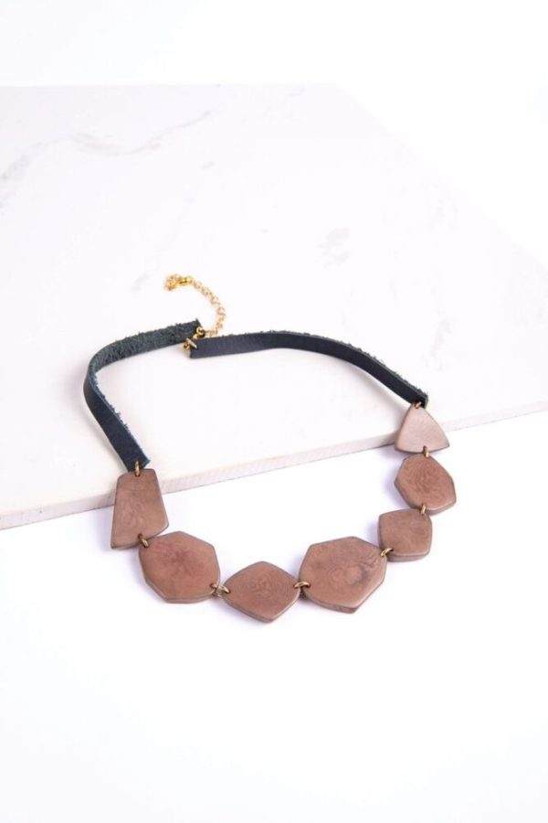 Ethically made trendsetting Wonder necklace made with 7 asymetric cut tagua seeds placed wonderfully on leather.