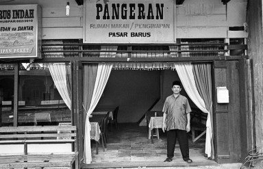 Ustadz Pangeran in front of his restaurant