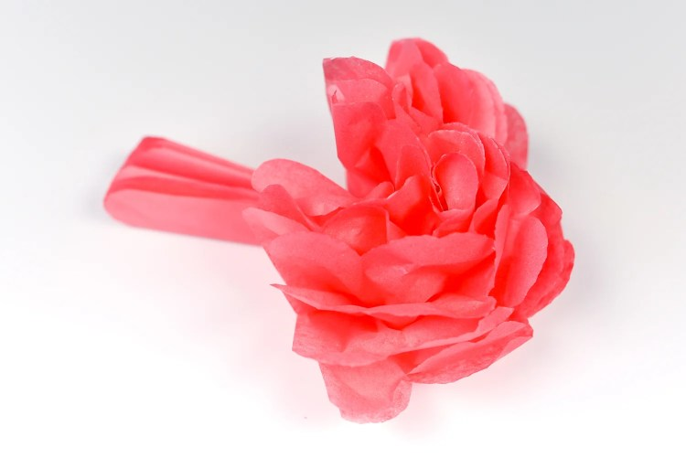 How to Make Tissue Paper Flowers: Carefully start to separate the layers of the flower.
