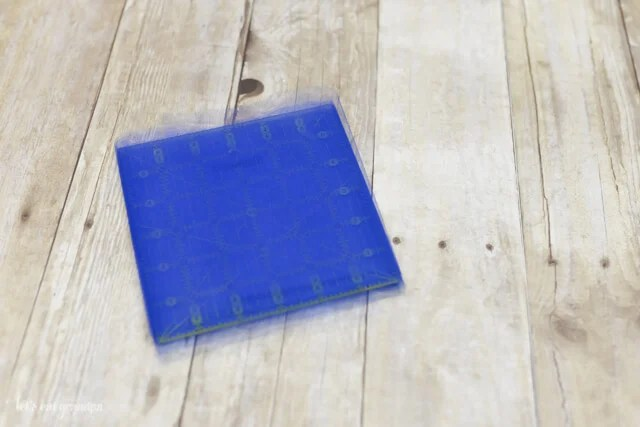 blue tulle wrapped around square cardboard