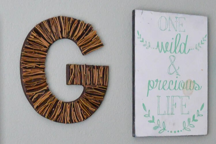 G initial and wall art hung on wall