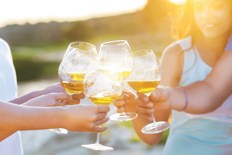 group of friends toasting a glass of white wine