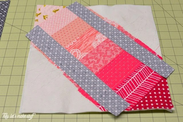 fabric layered all the way down on batting on sewing mat
