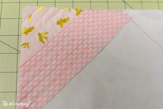 fabric corner and fabric strip on sewing mat and batting