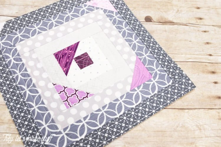 Quilt-as-you-go (QAYG) finished purple and gray block up close