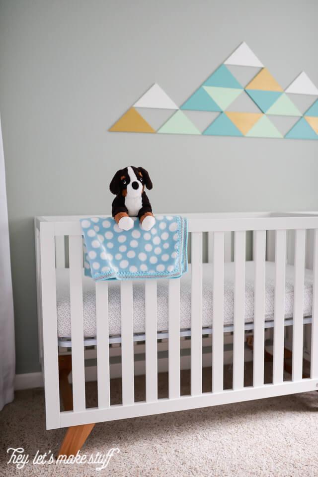 DIY geometric mountain on wall above crib