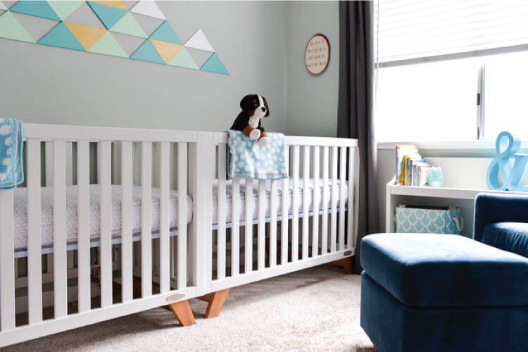 Our little adventurer twin nursery! We wanted a simple theme for our twin nursery, so we went with teals and grays, mountains and coziness.