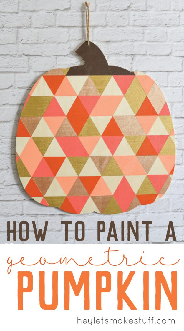geometric painted pumpkin hanging on white brick fireplace pin image