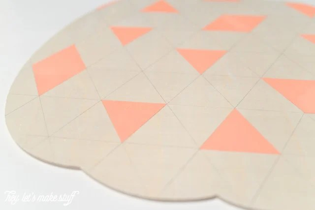 geometric pumpkin with tape peeled off to show painted triangular parts