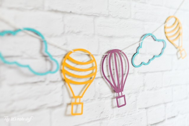 hot air balloon cut files strung on wall