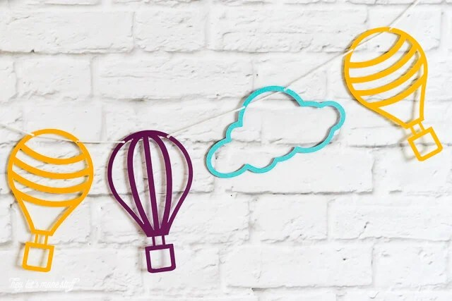 Get these free hot air balloon cut files, which can be cut on a Cricut or Silhouette!