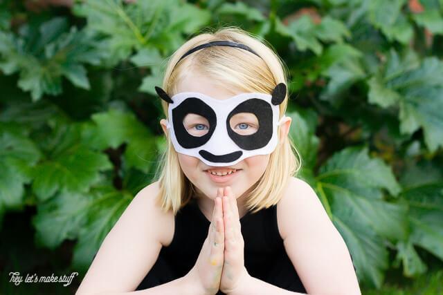 young girl wearing DIY Kung Fu panda mask