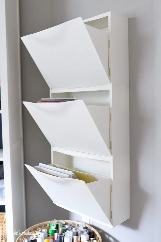 Craft paper storage ideas. Use this IKEA Hack: Trones Shoe Holders are the perfect size and shape for holding all of your paper! Plus it takes up so little space in your craft room.
