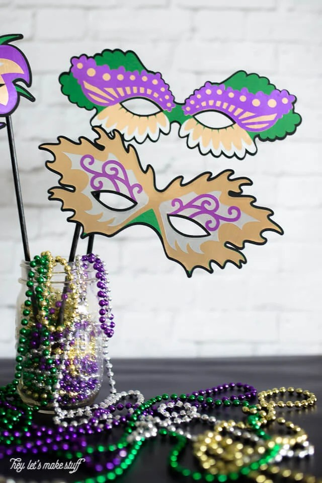 finished cut out colorful Mardi Gras masks made from paper